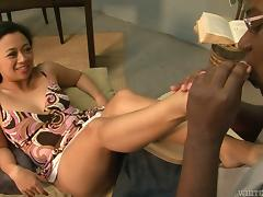 Asian hussy Lucky Starr gives a passionate footjob to a black dude