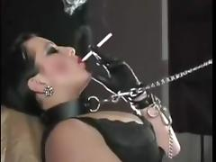 Sexy girl smoking in leather outfit