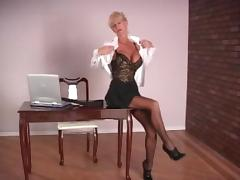 Mature woman with fake tits masturbates in an office