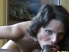 Tattooed brunette milf rides a big black cock