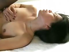 Brunette milf gets her shaved pussy fucked by a tattooed guy