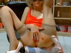 Granny dildoing and fisting her gaping pussy
