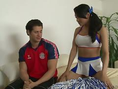 A beautiful tranny in a cheerleader uniform gets ass fucked