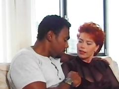 Mature redhead Kira Red is getting black dick