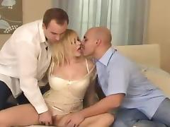 Luscious blond siren is enjoying two men at a time