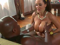 Huge breasted Lisa Ann gives a handjob and a titjob