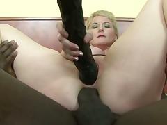 Blonde mature milf riding black cock in both holes