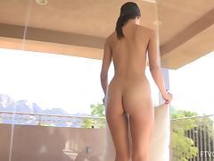 Tiffany enjoys masturbating her pussy on the balcony