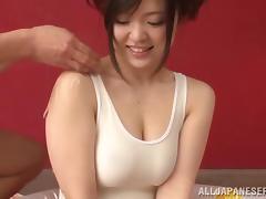 Japanese Hottie in a Wet T-shirt Gives a Handjob