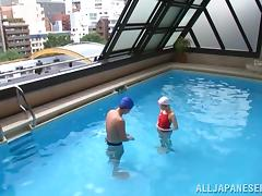 Japanese Girl in a Swimsuit Fucking in and out of The Pool