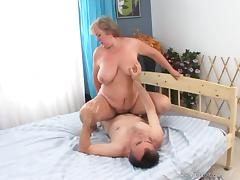 Mature fat blonde gives a blowjob and jumps on a cock