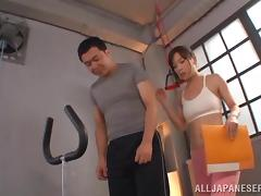 A hot Japanese girl in a sportswear rides a dick in a gym