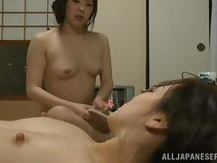 Two Japanese girls with perky tits finger their hairy pussies