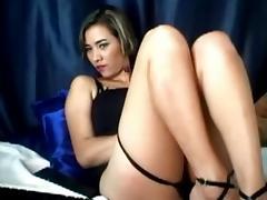 Teenage bitch rubbing her clitoris on web camera