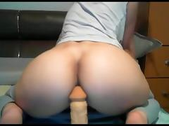 Webcam whore fucks her ass with large dildo