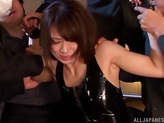 Saki Kouzai kinky Asian babe in latex fucked in group sex