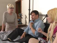 Two slutty blondes share a cock in a kinky FFM threesome sex clip