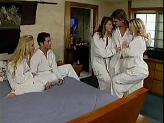 Three sexy babes enjoy ardent group sex in a hotel room