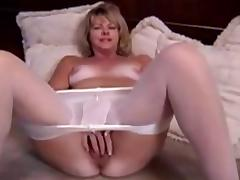 Mature blonde masturbating in pantyhose and dildo