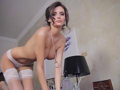Breathtaking brunette beauty shows off her perfect curves