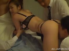 Sizzling Japanese chick enjoys a gangbang in a hotel room