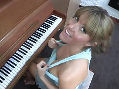 Sexy blonde Talia is playing on piano