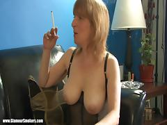 Matured Cougar In Black Fishnets Smoking Heavily Indoors