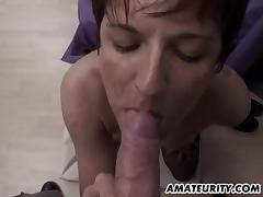 Short-haired mature hussy blows adn gets fucked doggystyle