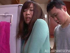 Beautiful Asian girl with a hot ass enjoying a hardcore fuck in her kitchen