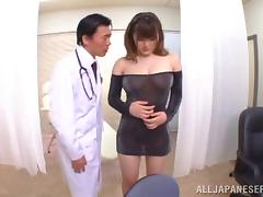 Japanese babe in nylon gives blowjob and rubs cock between her tits