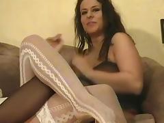 Beautiful chubby lesbian in nylon stocking unpinning her attire while showcasing her big tits