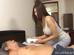 Stunning Asian cougar with long hair giving her gentleman blowjob in reality shoot