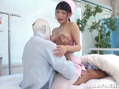 Angelic nurse with big tits in uniform awarding massive dick with superb titjob