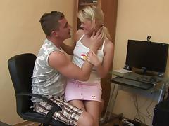 Mini-skirt clad teen with long blonde hair enjoying a hardcore missionary style fuck