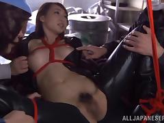 A Japanese girl in leather is tied up and gang banged in a garage
