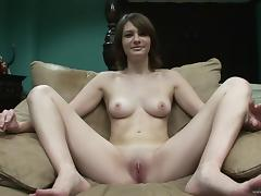 Solo model with natural tits masturbates her shaved pussy