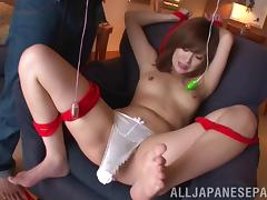 Elegant Japanese pornstar in bondage having her tits fiddled before being drilled with vibrator