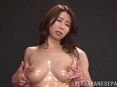Attractive Asian dame moaning as her big tits gets oiled gently buy her dude