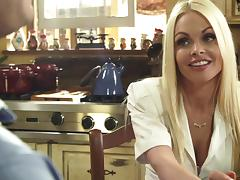 Blonde MILF porn star Jesse Jane embraces her big tits as they are tainted by streams of cumshots